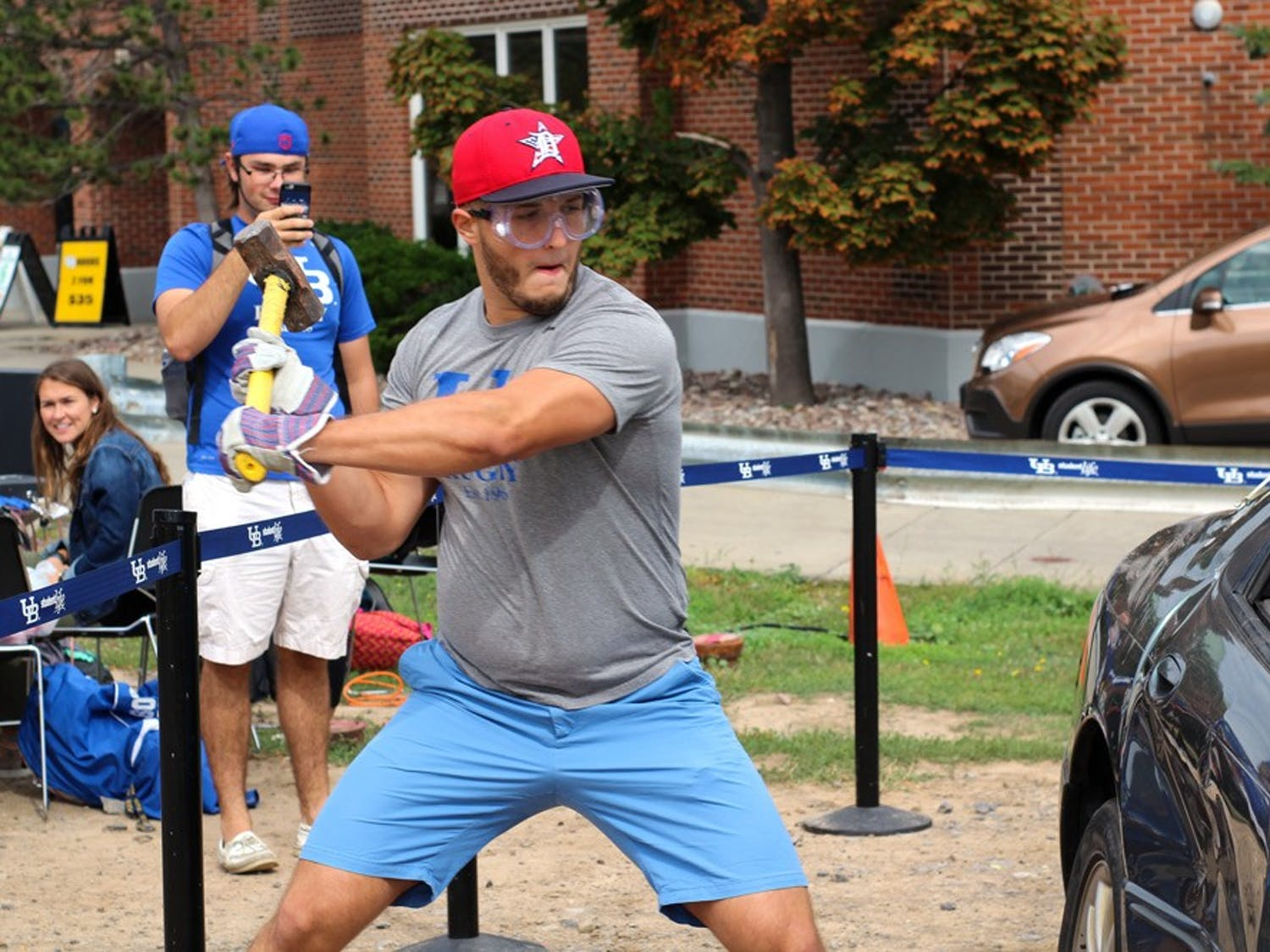 UB men's rugby club team and women's soccer club team hold annual car smashing event outside of the Student Union to promote drunk driving awareness.