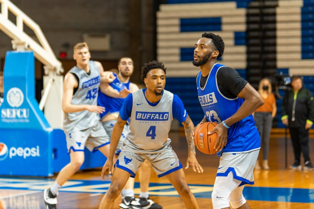 UB guard Maceo Jack (33) is guarded by guard Keishawn Brewton (4) at men's basketball practice last week.