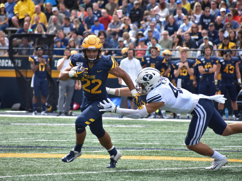 Toledo sophomore running back Bryant Koback breaks a tackle during a 28-21 victory over BYU.