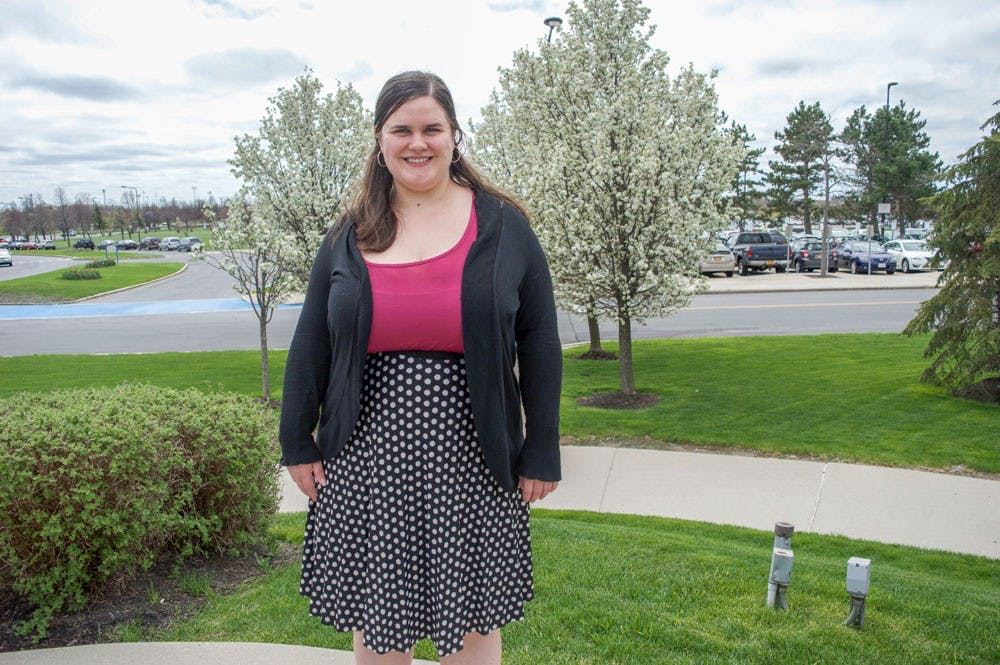 <p>Hilary Vandenbark, Ph.D candidate, stands outside of Alumni Arena. Vandenbark is a sexual assault survivor and wants administration to be more transparent when discussing sexual assault on campus.</p>
