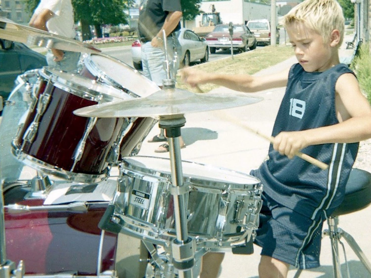 Justin Bieber's hometown is honoring him at the Stratford Perth Museum in Steps to Stardom, an exhibit which highlights Bieber's journey to fame. Bieber was a regular street performer in Stratford, Ontario, as shown above playing drums in 2002.