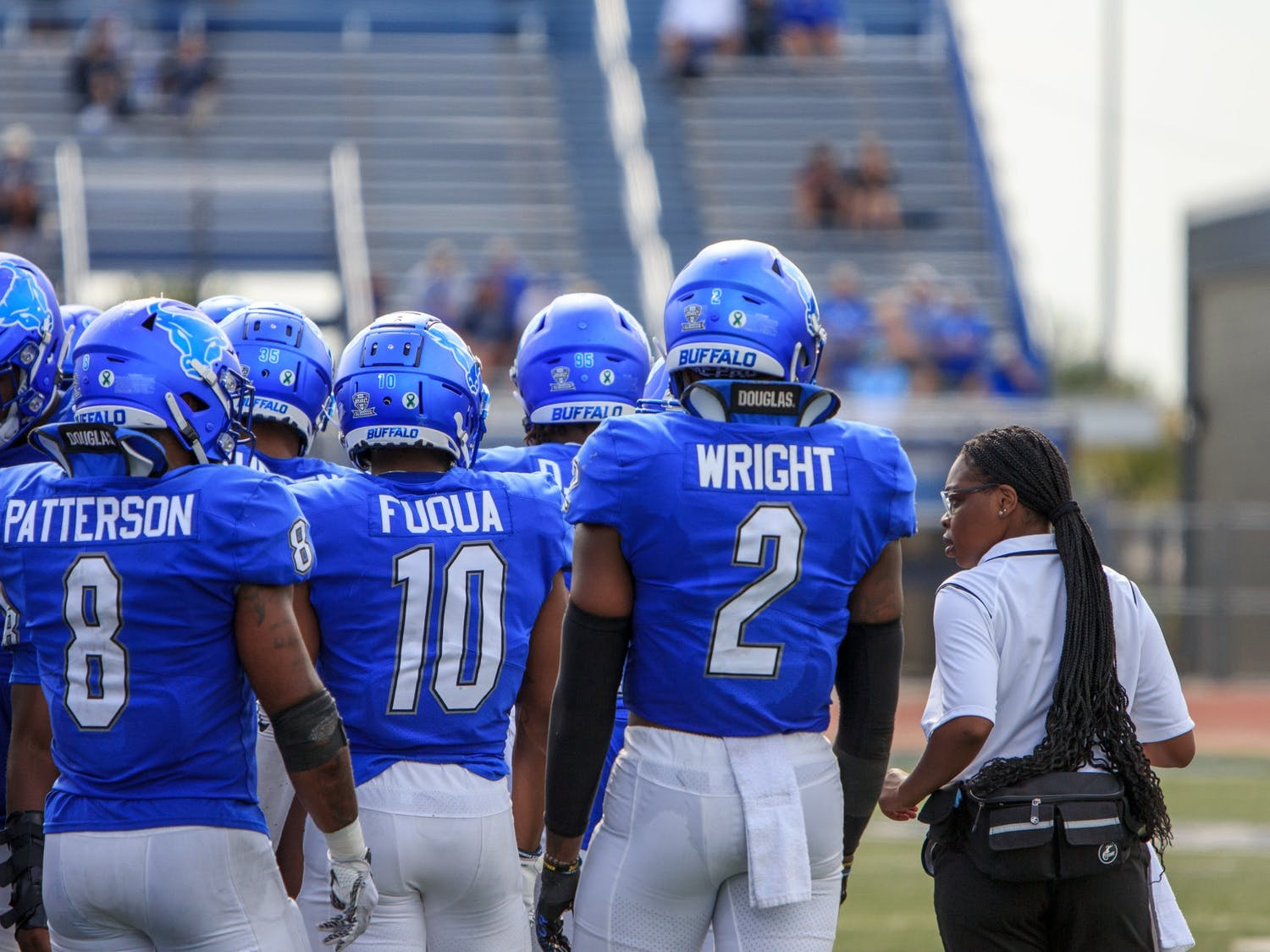 Safety Marcus Fuqua (10) and linebackers Kadofi Wright (2) and James Patterson (8) get ready during a timeout.