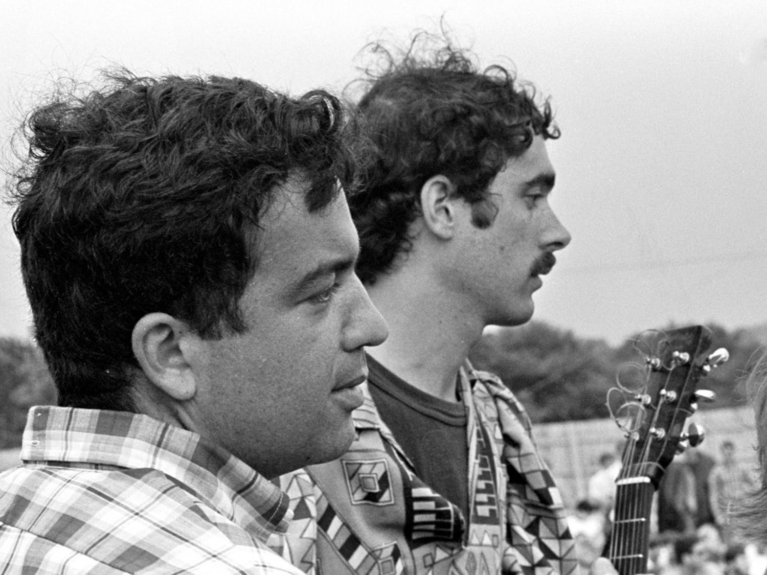 Professor Bruce Jackson (left) chats with Jim Kweskin (right) at the 1967 Newport Folk Festival. Jackson was on the festival board from 1965 to 1968. He claims that fans didn't boo Bob Dylan during his infamous 1965 festival performance.
