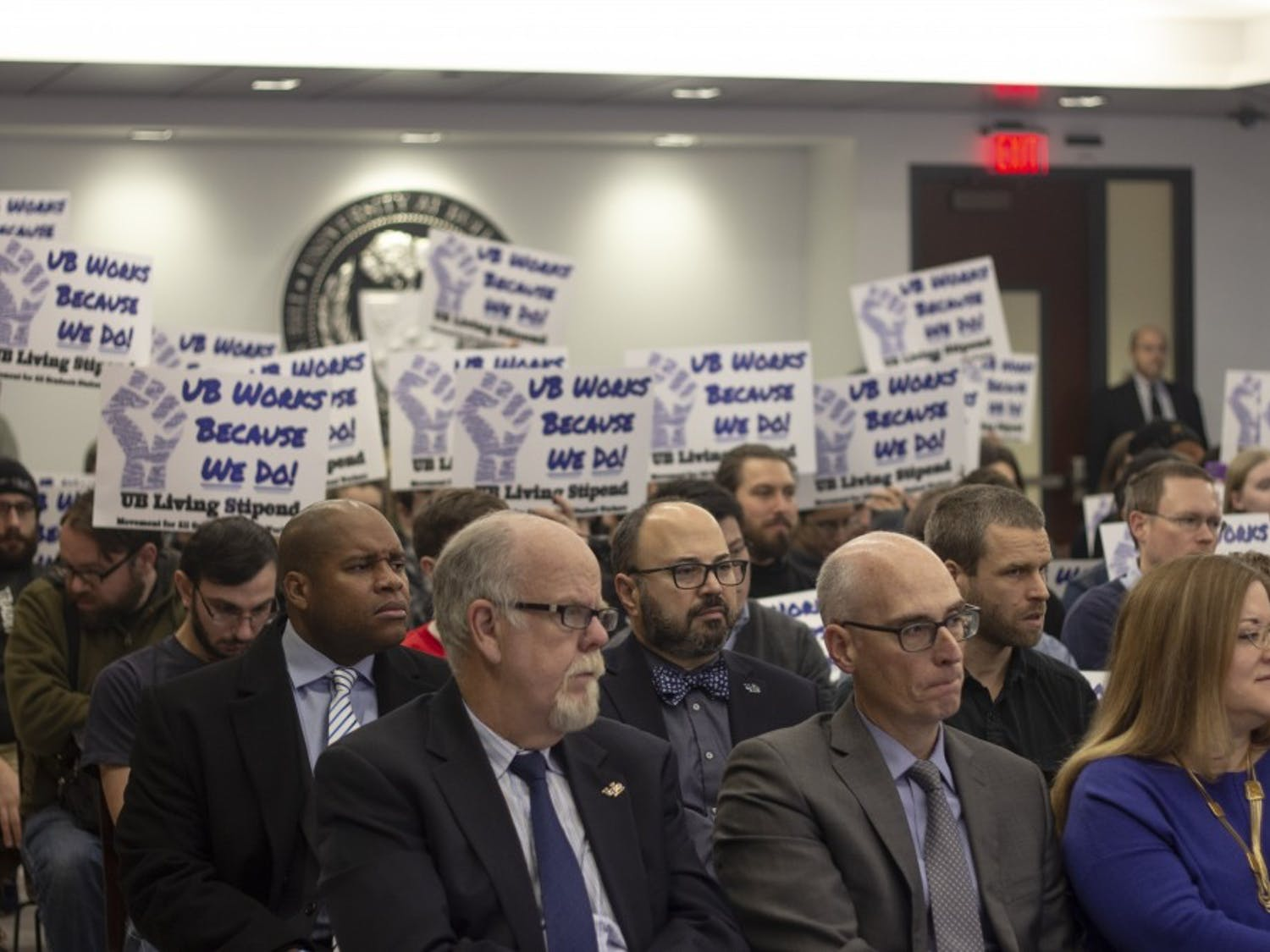 Graham Hammill (front center), vice provost for Graduate Education and dean of the Graduate School, sits among other UB administrators as Living Stipend movement members protest behind him.
