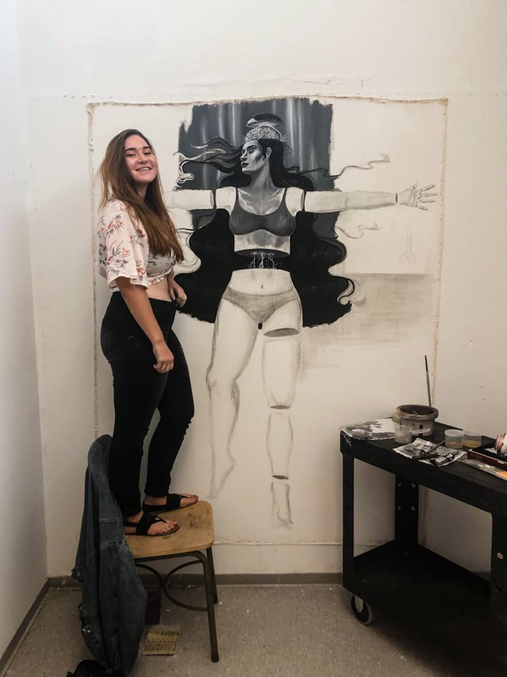 <p>Emily Quartley poses with her life-sized drawing.</p>