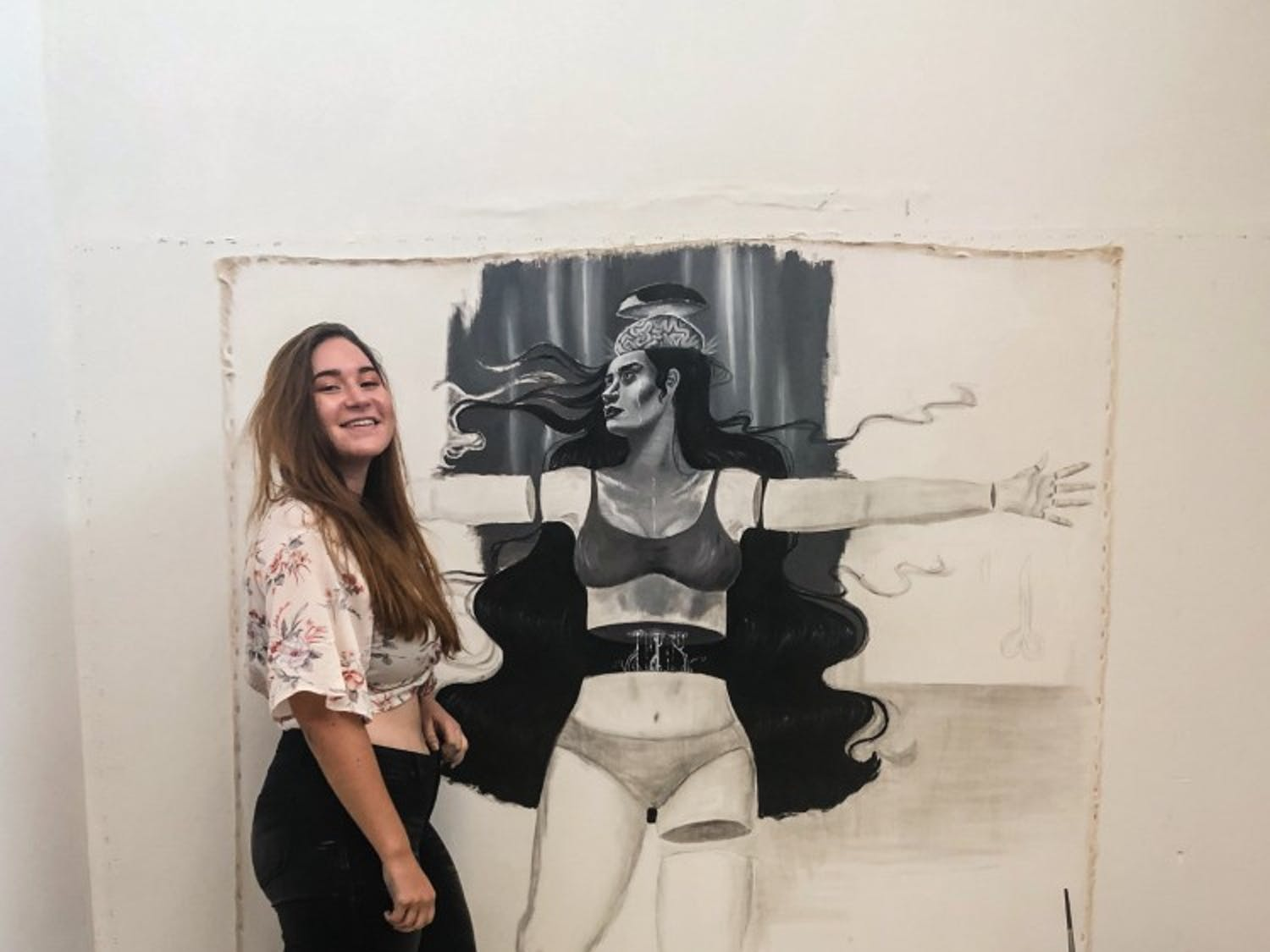 Emily Quartley poses with her life-sized drawing.