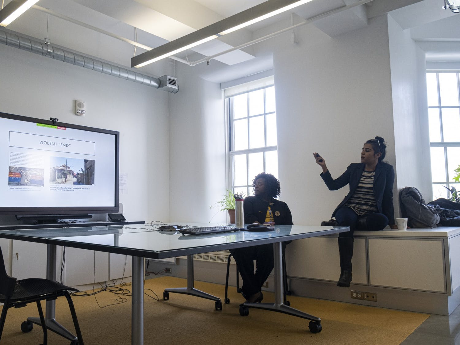 Kafuli Agbemenu (left) and Shaanta Murshid (right) present two different yet connected perspectives on women's health during a Global Health Equity Brown Bag Seminar.