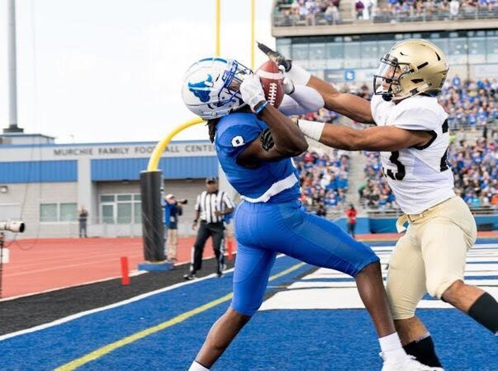 <p>Former UB football star K.J. Osborn makes a catch in the endzone.&nbsp;</p>
