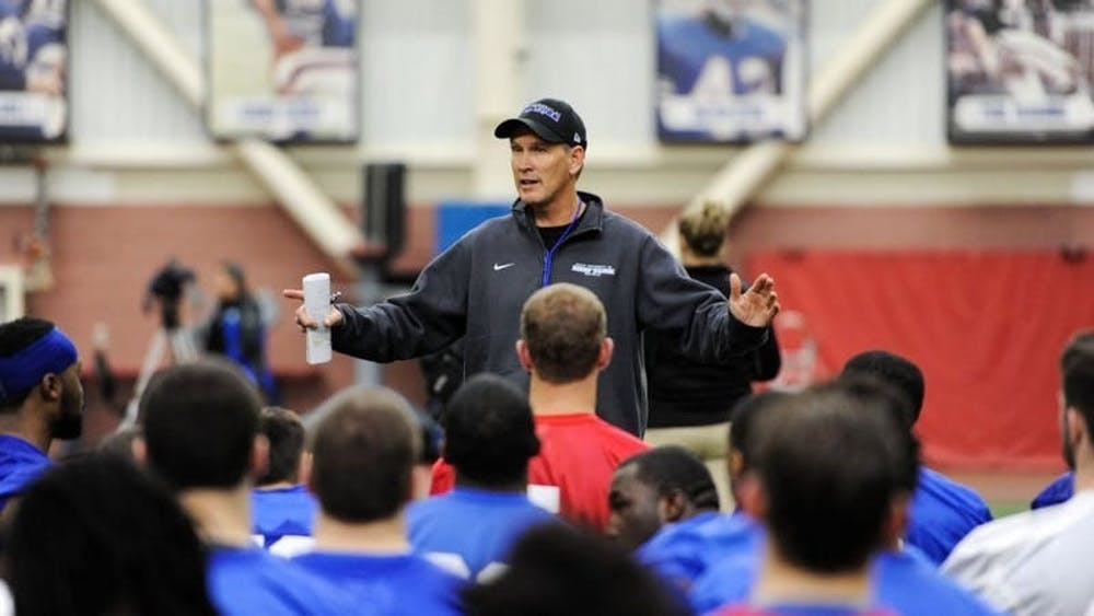 UB football head coach Lance Leipold talks to his team.