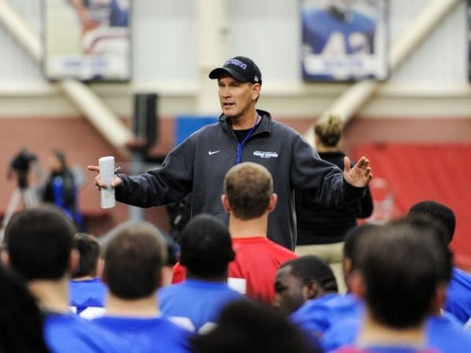 UB football head coach Lance Leipold talks to his team.