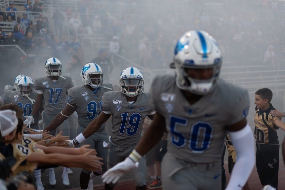 The Bulls storm UB Stadium during an early game this season.