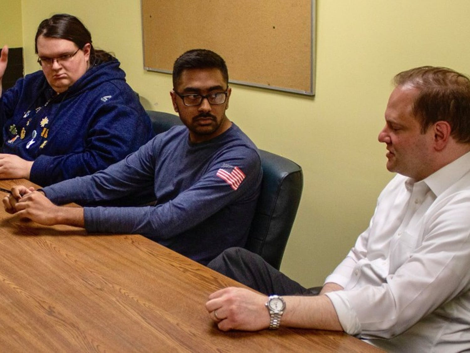 (left to right) Connor Walters, Arsh Issany and Joshua Lippes discuss UB's decision to dissolve Sub-Board I. The Faculty Student Association will take over SBI's investment accounts on July 1.