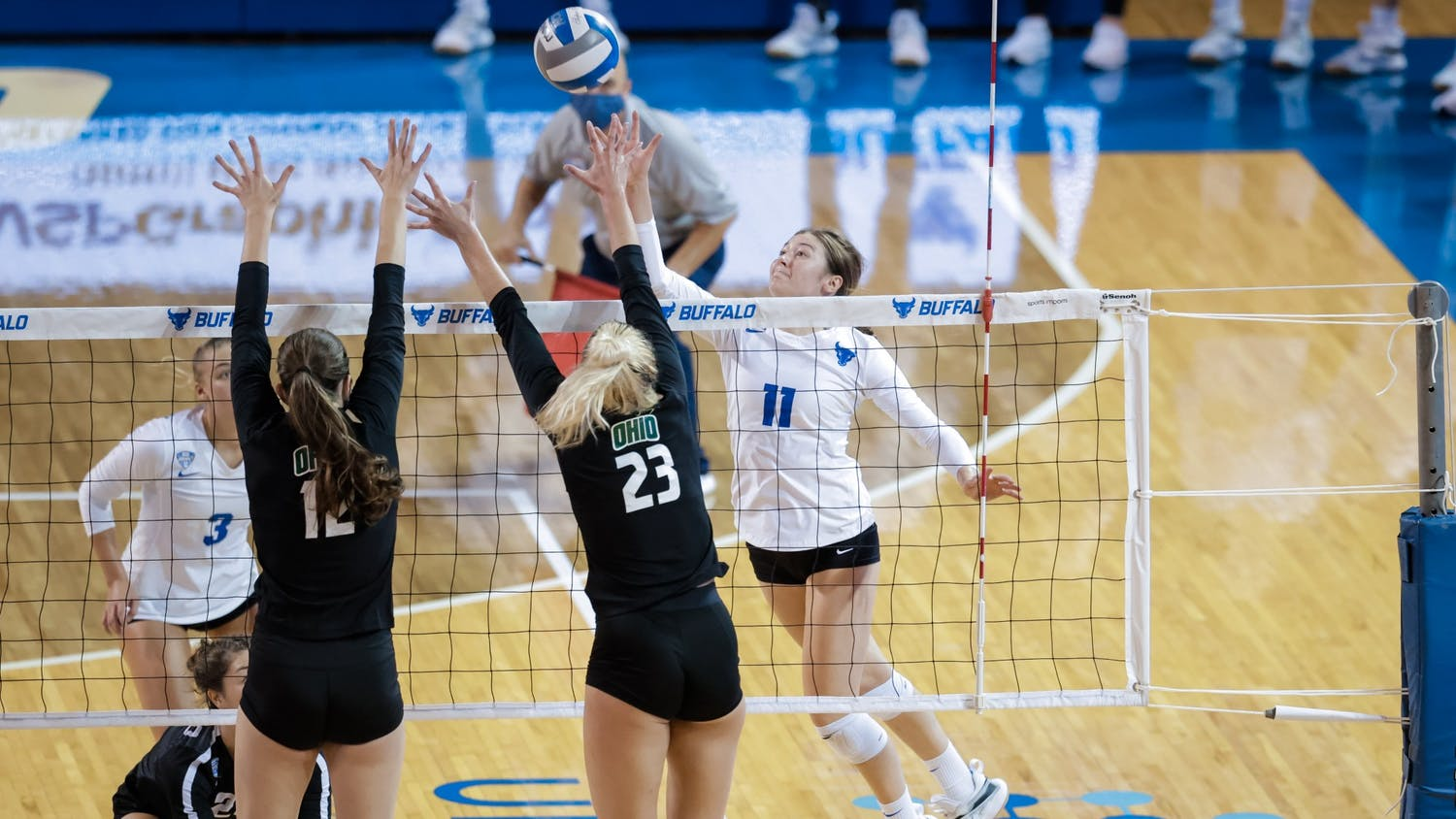 Freshman outside hitter Maria Futey (11) goes for a spike during a recent game against Ohio.