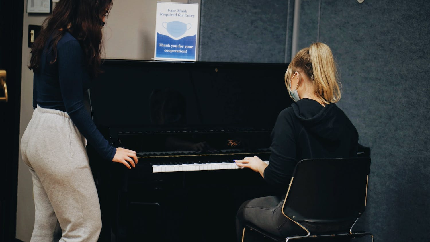 Junior occupational therapy majors Ciana and Hannah play the piano located in 145a Student Union