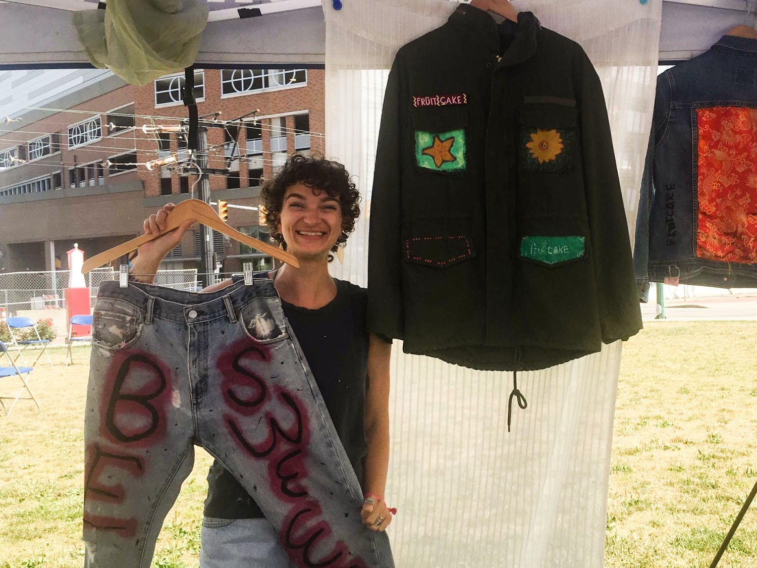 Julia Erbacher selling upcycled pieces at a local art festival.