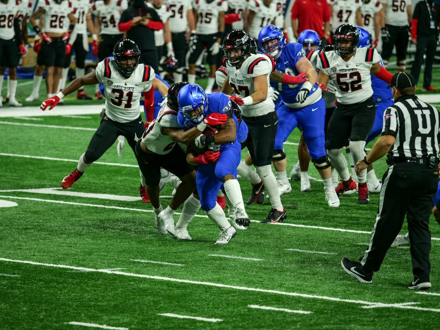 Junior running back Jaret Patterson rushes for a first down against Ball State in the MAC Championship Game.