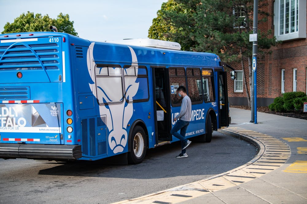 Students board the Stampede during the fall 2020 semester. Parking and Transportation Services says an operator shortage is to blame for reduced operations.