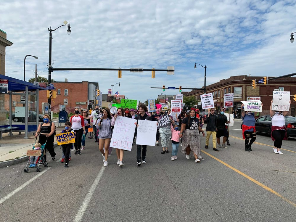 Chants and honking horns filled the streets as protesters marched down Niagara Street from Prospect Park.
