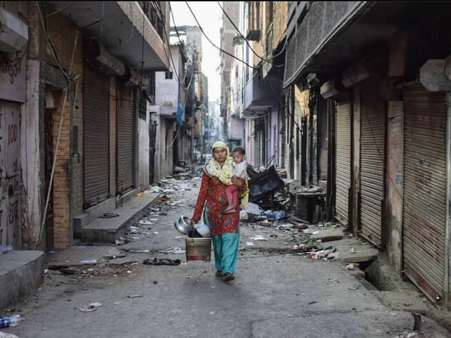 Residents of Chand Bagh in northeast Delhi leaving their homes amid the riots.
