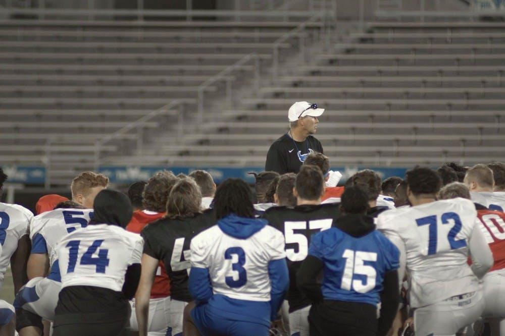 <p>Head football coach Lance Leipold talks strategy with the UB football team.&nbsp;</p>