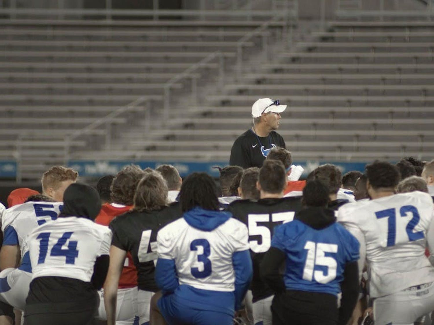 Head football coach Lance Leipold talks strategy with the UB football team.