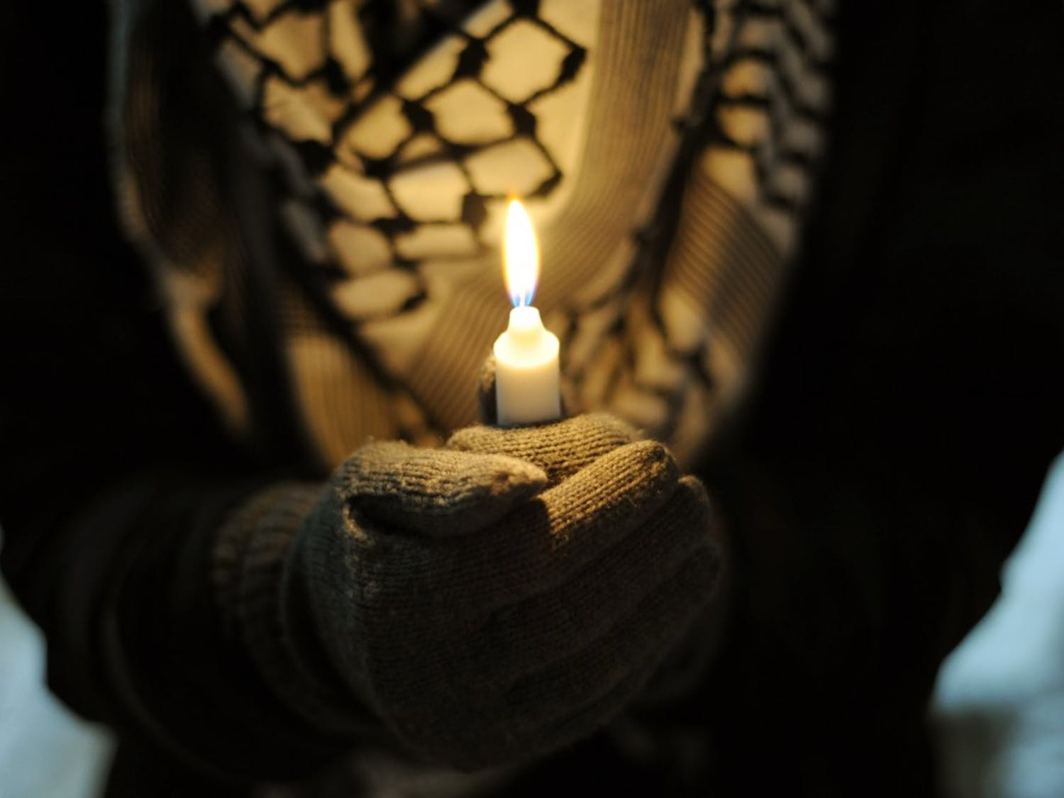 UB students honor Muslim students fatally shot in Chapel Hill with candlelight vigil.