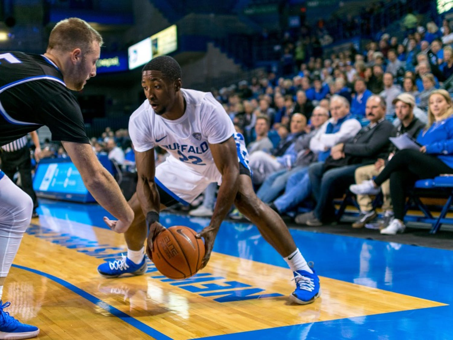 Senior guard Dontay Caruthers picks up his dribble in the corner in a previous game. Caruthers had a career-high 28 points in UB's loss against Bowling Green.