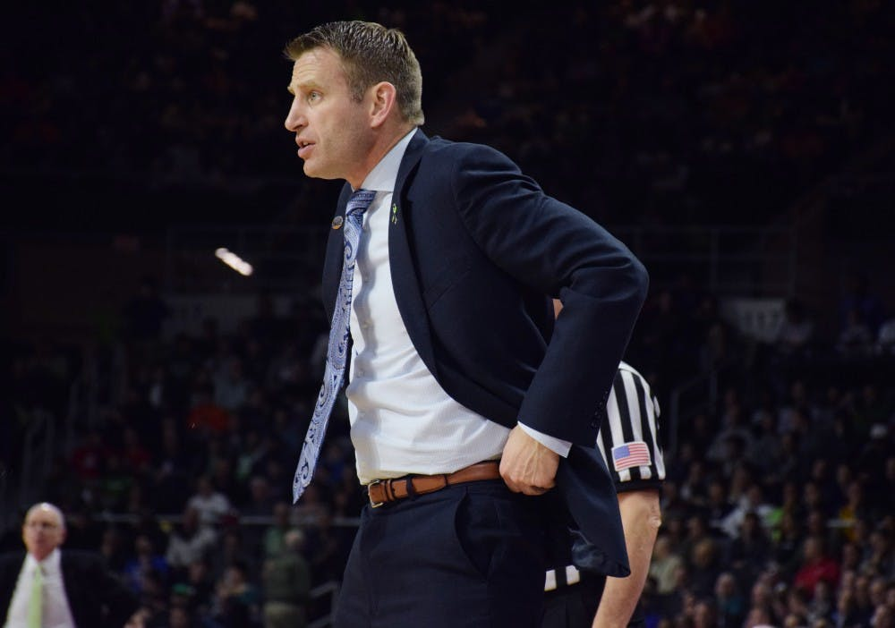 <p>Head coach Nate Oats looks on during Buffalo's NCAA tournament loss in 2016. Oats resigned from UB in 2019 and is now the head coach at University of Alabama.&nbsp;</p>