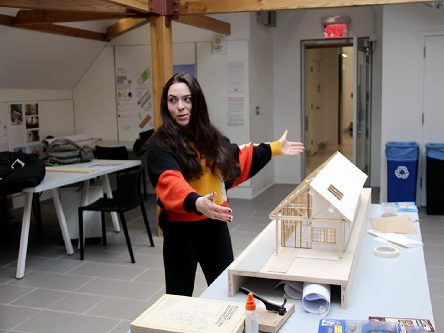Graduate student Alexa Russo stands in front of a model constructed from her affordable housing design. Russo designed the one-story row-house as a model for students to eventually build a home for a Buffalo family.