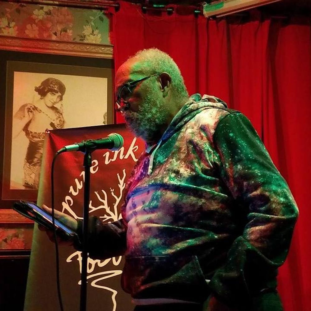 Dr. Scott Williams reads at the Pure Ink poetry slam at Buffalo's Gypsy Parlor. Friends of Williams said his readings are  unlike anything they've heard before.