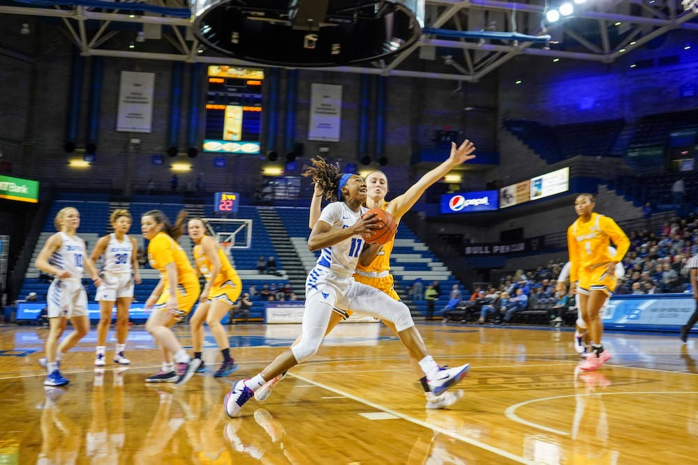 <p>Former UB women's basketball guard Theresa Onwuka goes in for a shot during the game against Kent State in the Alumni Arena on March 6, 2020.</p>