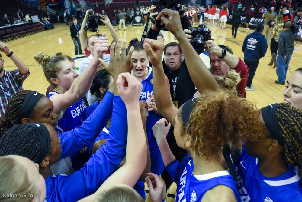 <p>The women's basketball team huddles after its win against Ball State Wednesday night.&nbsp;</p>