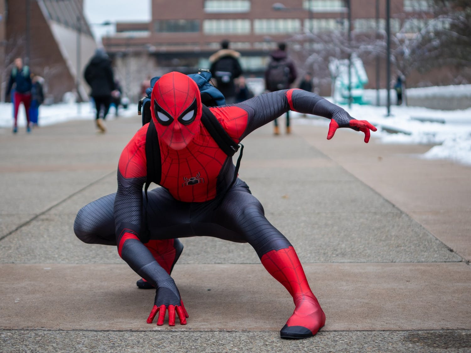 UB Spider-Man recreates iconic Spider-Man poses outside Student Union.