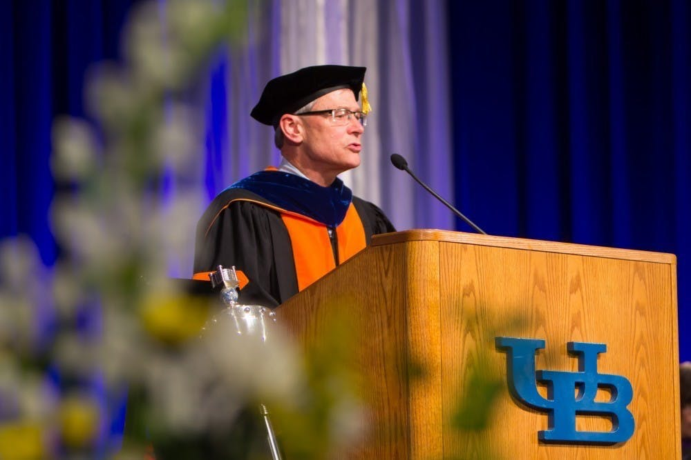 <p>Former UB provost Charles Zukoski speaks to graduates at the university's 2018 commencement ceremony.</p>