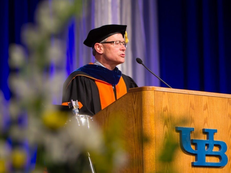 Former UB provost Charles Zukoski speaks to graduates at the university's 2018 commencement ceremony.