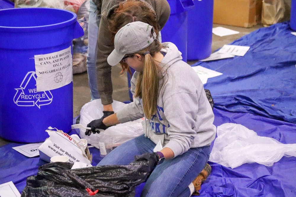<p>UB students from the Sustainable Urban Environments digging through waste at Tri-Main to help improve their waste process.</p>