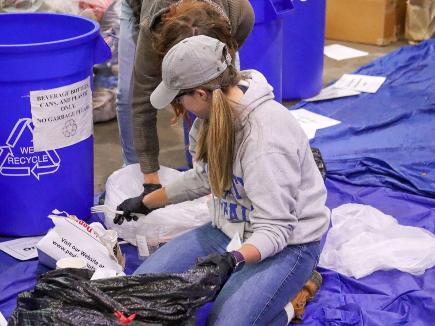 UB students from the Sustainable Urban Environments digging through waste at Tri-Main to help improve their waste process.