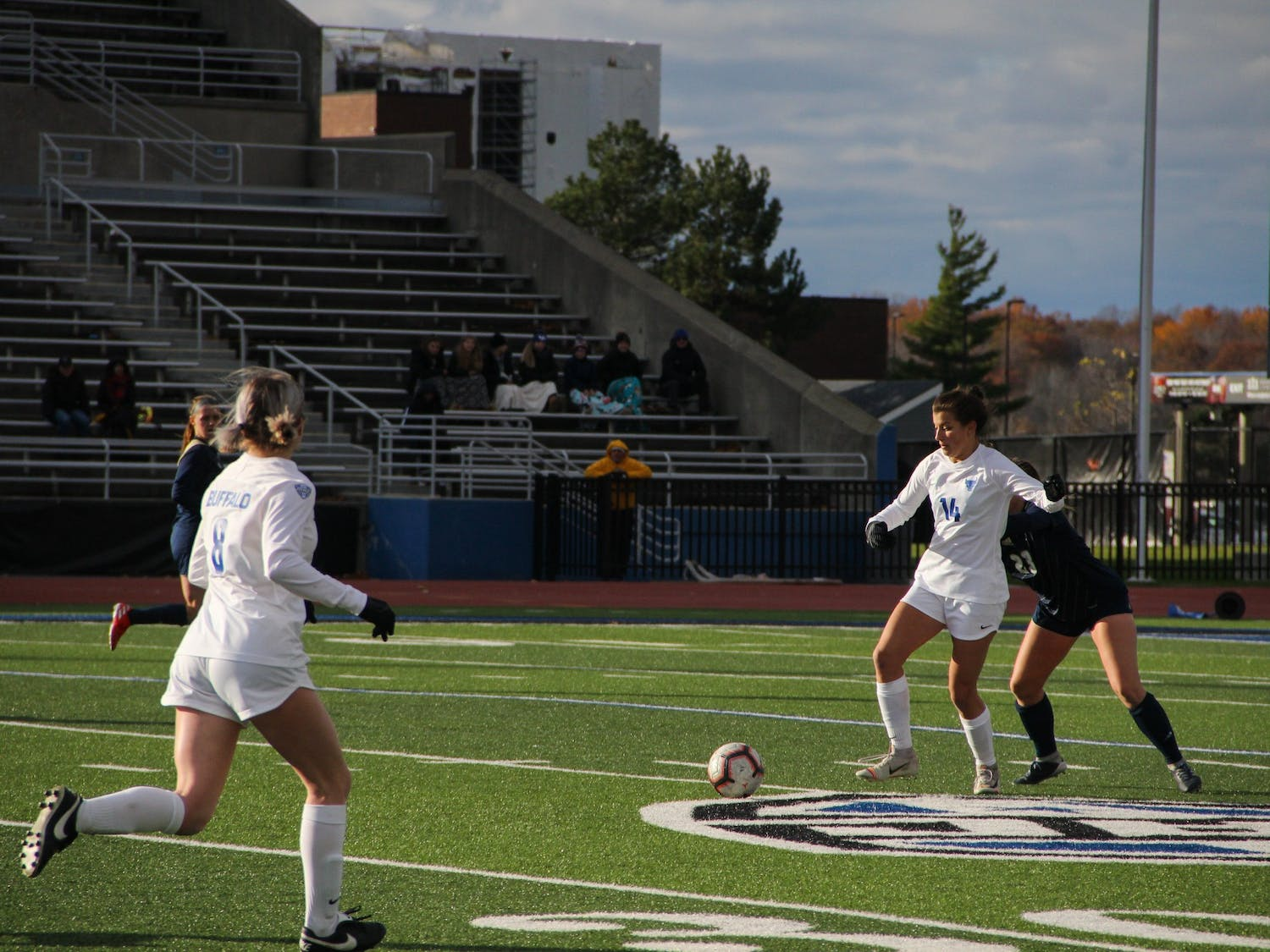 Sophomore Taylor Caridi secures the ball against a defender at Sunday's soccer game.