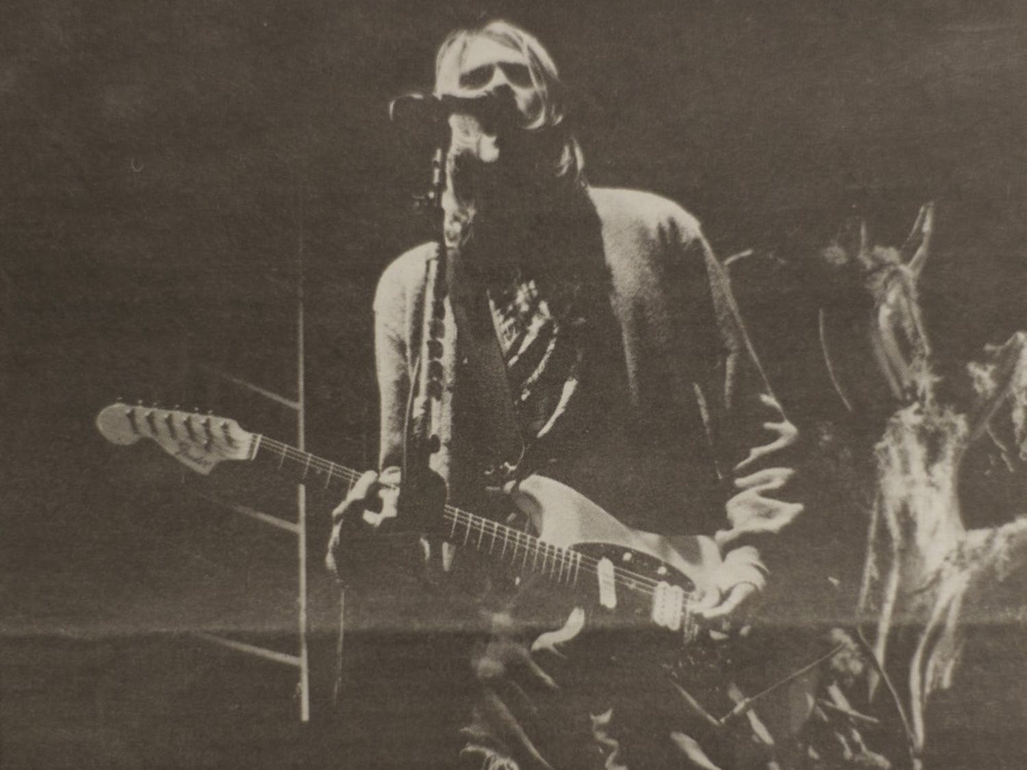 Kurt Cobain shreds in front of 7,000 fans at Alumni Arena in 1993. Cobain and his band Nirvana played a sold-out show at UB 25 years ago today, and students brought them here.