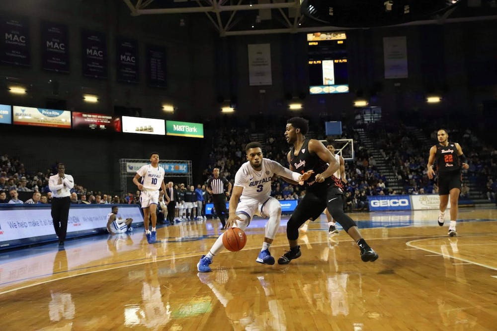 <p>&nbsp;Junior guard Jayvon Graves dribbles past a Bowling Green defender.</p>