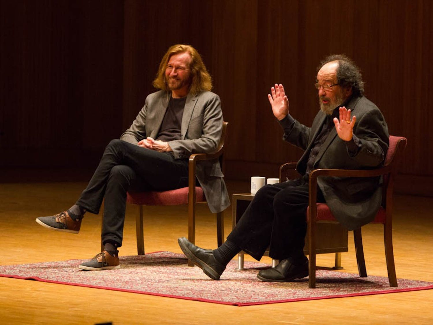 Tom Toles (left) speaks with his friend and SUNY Buffalo Arts initiative co-director Bruce Jackson (right) at Slee Hall on April 14, 2016.