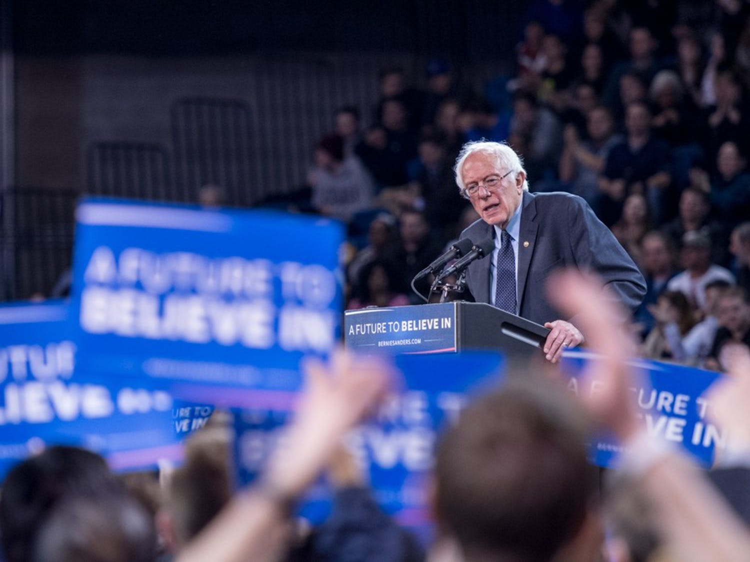 """Democratic presidential candidate Bernie Sanders spoke at Alumni Arena for his """"A Future to Believe In Rally"""" on Monday night. More than 8,000 people packed the arena to hear him speak."""