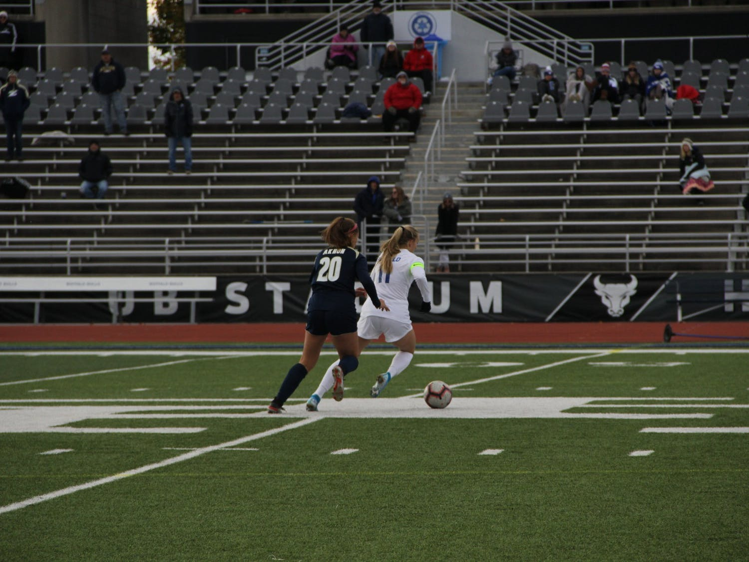UB midfielder Marcy Barberic defends the ball from an Akron player in 2019. UB split its weekend slate.