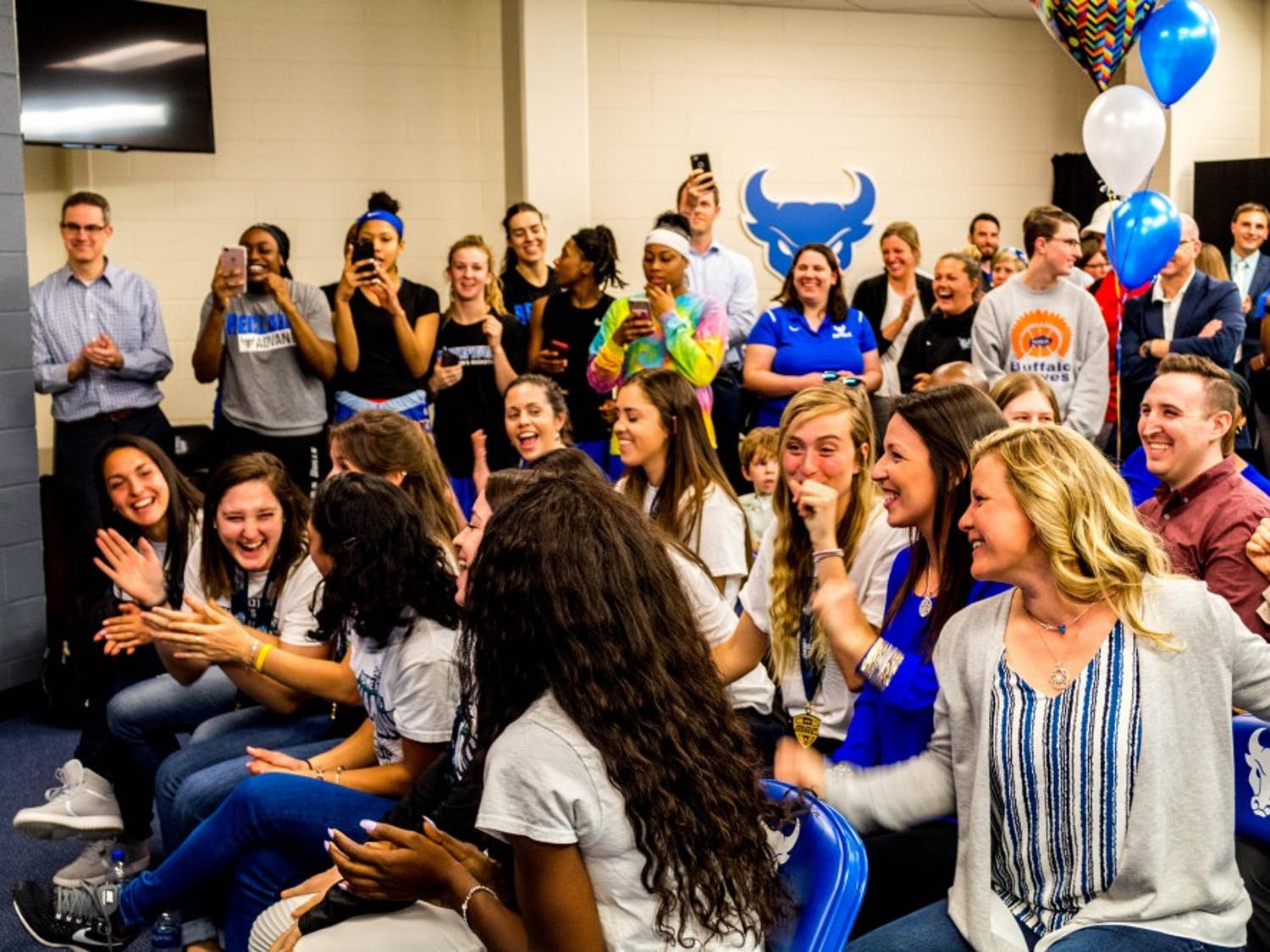 The women's tennis team reacting to the announcement of its first round NCAA Tournament opponent, the Northwestern Wildcats. The Bulls will travel to Evanston, Illinois for the first round matchup on May 11.
