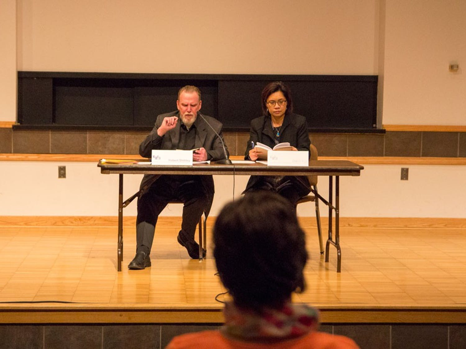 Co-chairs of the search committee, Robert Shibley and Diana Aga, speak at the first search committee meeting on Wednesday.About 30 faculty members attended the meeting to give their input about what they are looking for in the new dean of the College of Arts and Sciences.