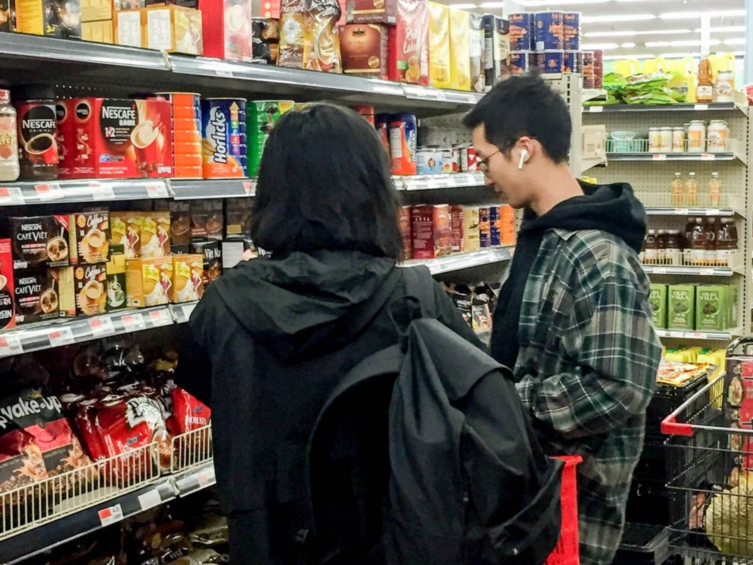Two students shopping at Asia Food Market. The new market bus brings students to and from the market every Tuesday from 4 p.m. to 8 p.m., and has already transported hundreds of students to the market.