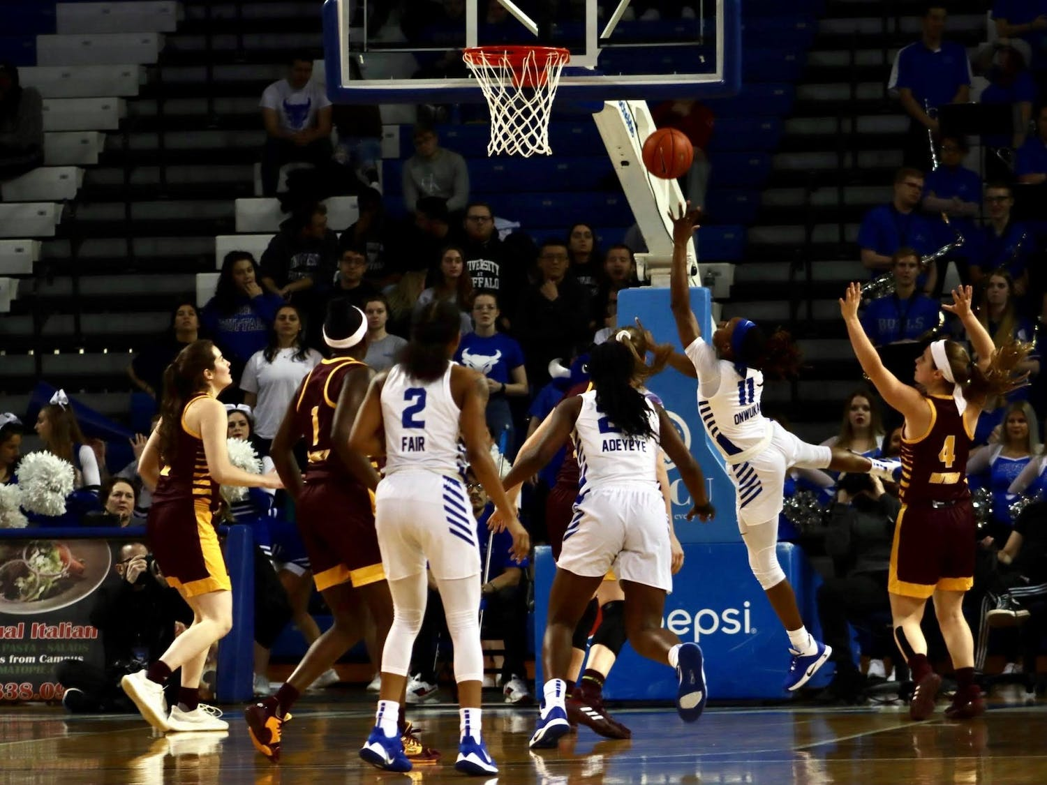 Senior guard Theresa Onwuka goes for a successful layup at Wednesday's game against Central Michigan.