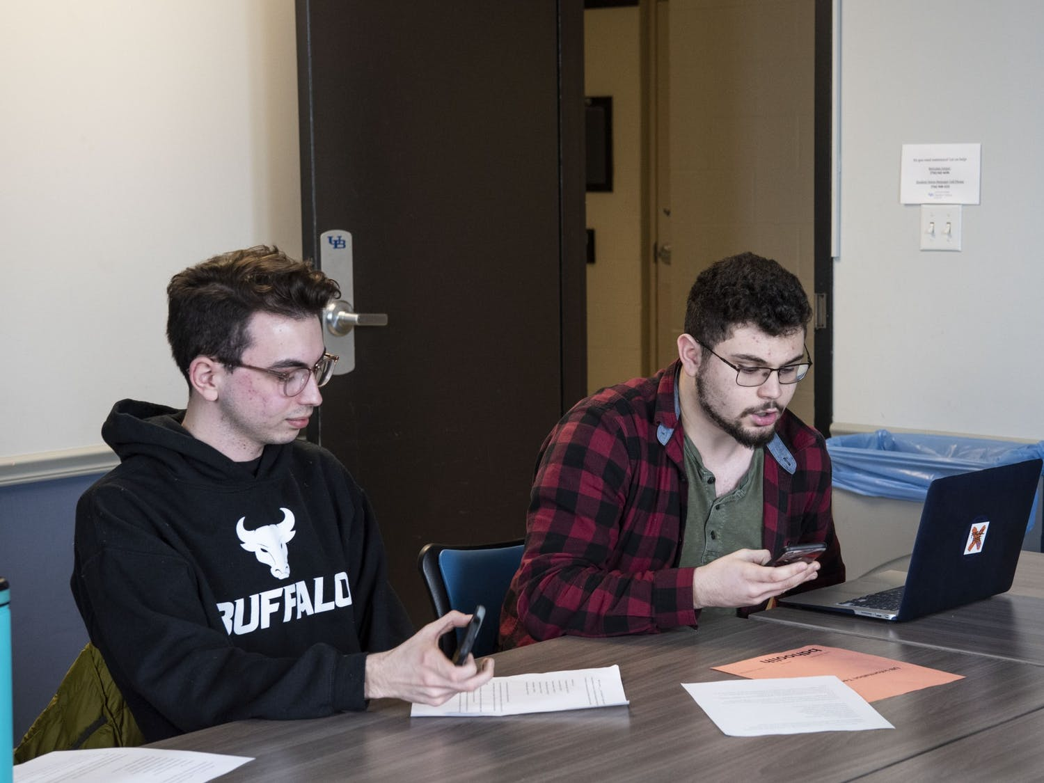 Sophomore Brendan Kelly and UB College Democrats President Brandon Hoolihan at the phone banking drive (left to right).
