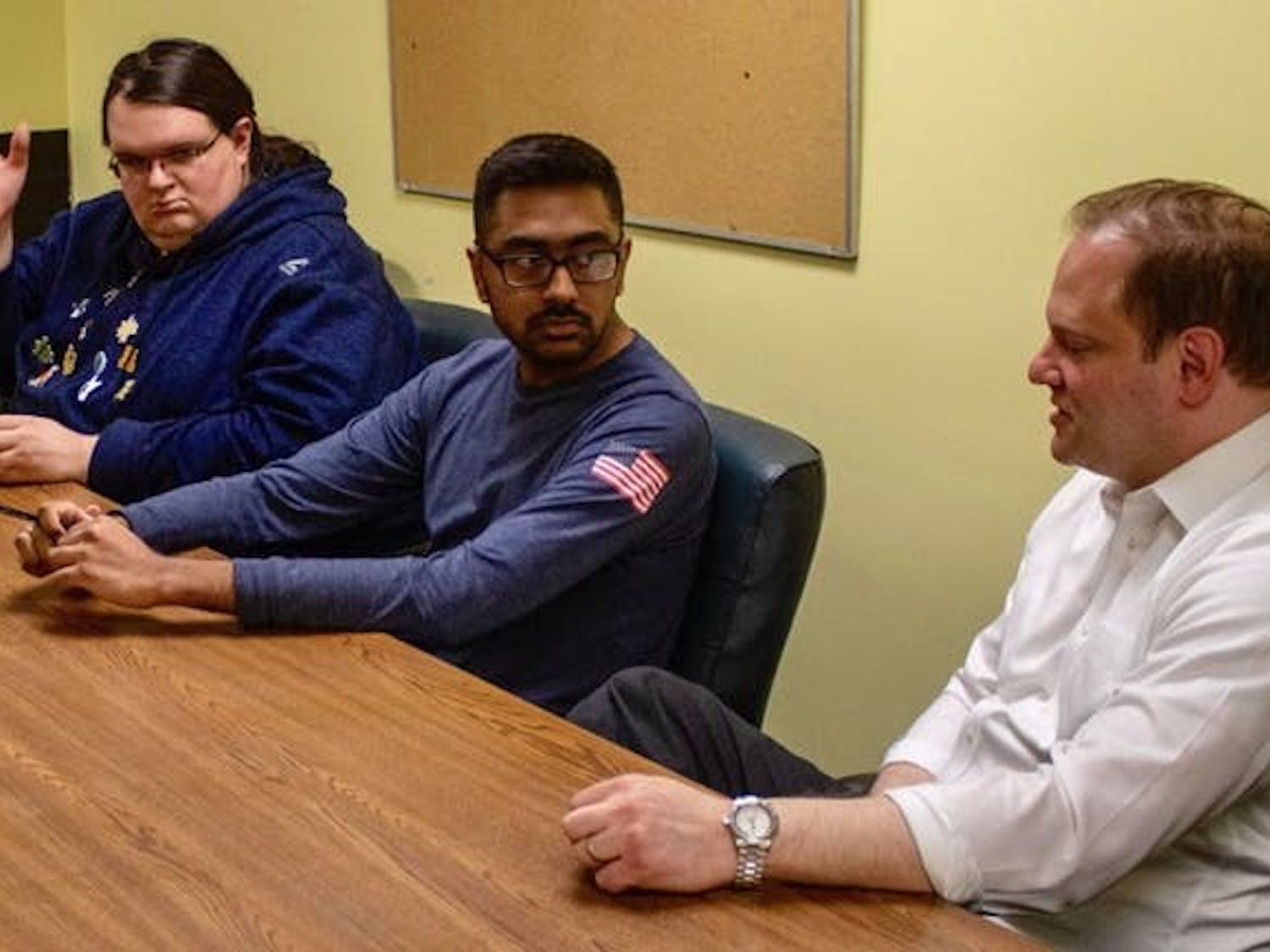 (Left to right) Connor Walters, Arsh Issany and Joshua Lippes discuss UB's decision to dissolve Sub-Board I in The Spectrum's office in May.