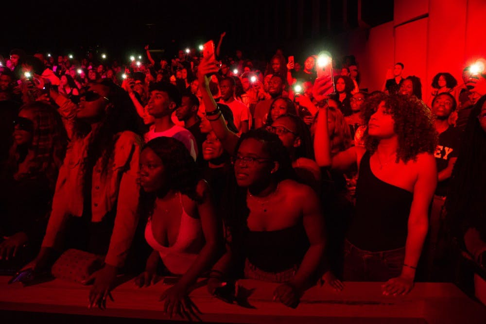 <p>Audience members light up their phones as they sing along to Kranium.</p>